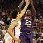 Northwestern State's Zeek Woodley takes a shot over Auburn forward Tyler Harris during the first half Friday at Auburn Arena.