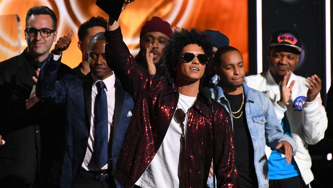 """Bruno Mars accepts Album Of The Year for """"24K Magic"""" during the 60th Annual Grammy Awards at Madison Square Garden on Sunday."""