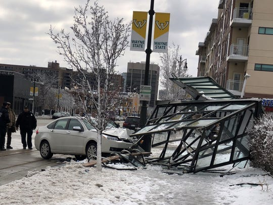 A white Ford Focus slammed into a bus stop on Woodward