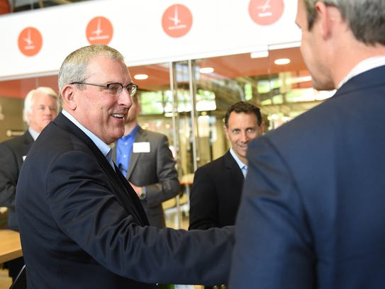 Mayor Wade Troxell socializes at Galvanize in Fort