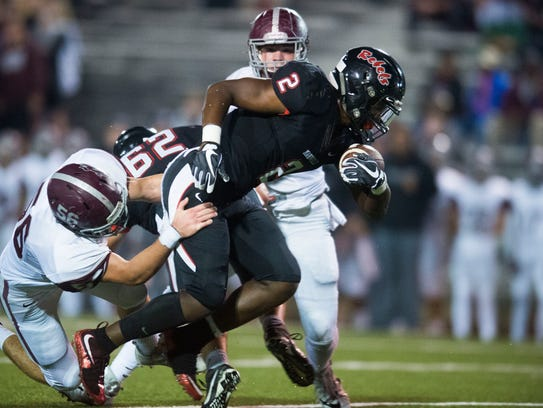 Maryville's Isaiah Cobb (2) is brought down by Bearden's