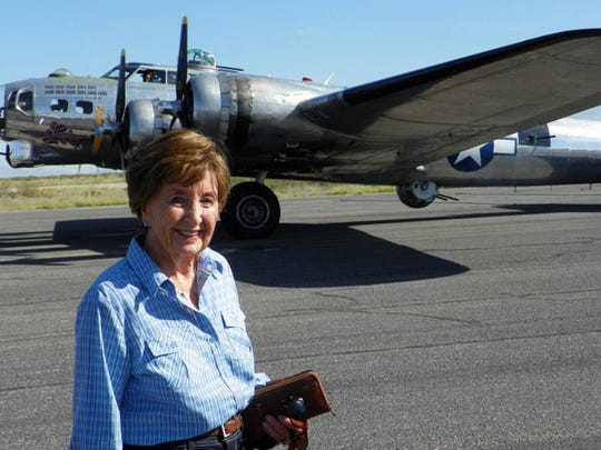 "Rosemary ""Rusty"" Windham, here at a recent visit to the War Eagles Air Museum in Santa Teresa, recalls her ""Rosie the Riveter"" days. The B-17 bomber behind her, she said, ""might be one I worked on during World War II."""