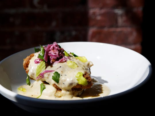 Aux Bar's buttermilk fried chicken and crumpet with black pepper gravy and slaw.