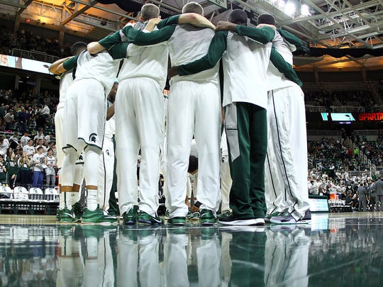 Michigan State Spartans huddle prior to a game at Jack Breslin Student Events Center in early December.