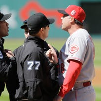 Cincinnati Reds manager Bryan Price, right, argues with umpires Manny Gonzalez (79) and Jim Reynolds (77) before playing the Cleveland Indians in a baseball game, Saturday, May 23, 2015, in Cleveland. Price was ejected from the game.