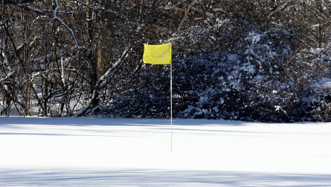 A heavy blanket of snow covers a green at Currie Park Golf Course in Wauwatosa just last Thursday after a spring storm.