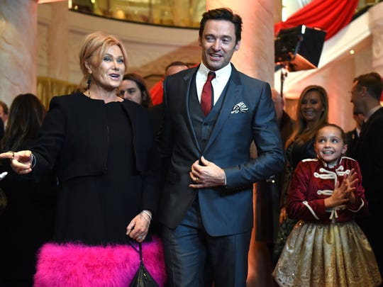 "Austyn Johnson, right, at the premiere of ""The Greatest Showman"" along with actor Hugh Jackman and his wife, Deborra-Lee Furness, at the  Brooklyn Cruise Terminal in New York on Dec. 8."