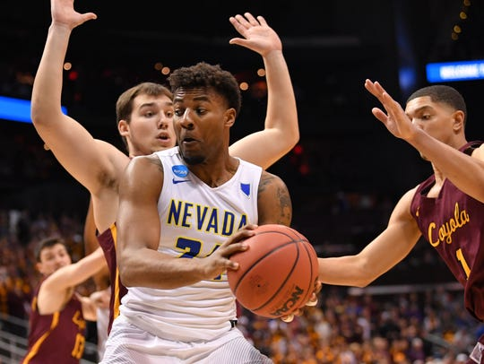 Nevada's Jordan Caroline looks for help against Loyola's Cameron Krutwig during the teams' South Regional game last season.