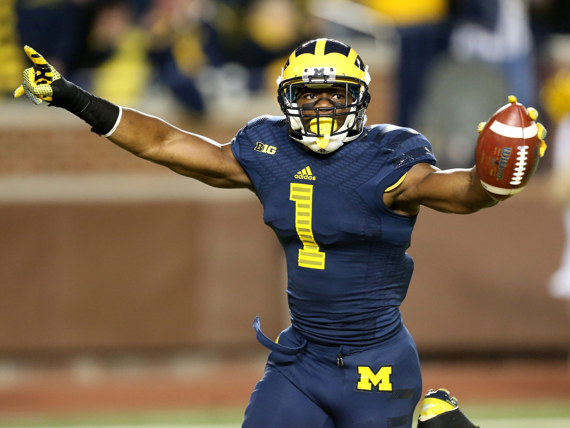 Devin Funchess of Farmington Hills catches a touchdown pass in Michigan Stadium.