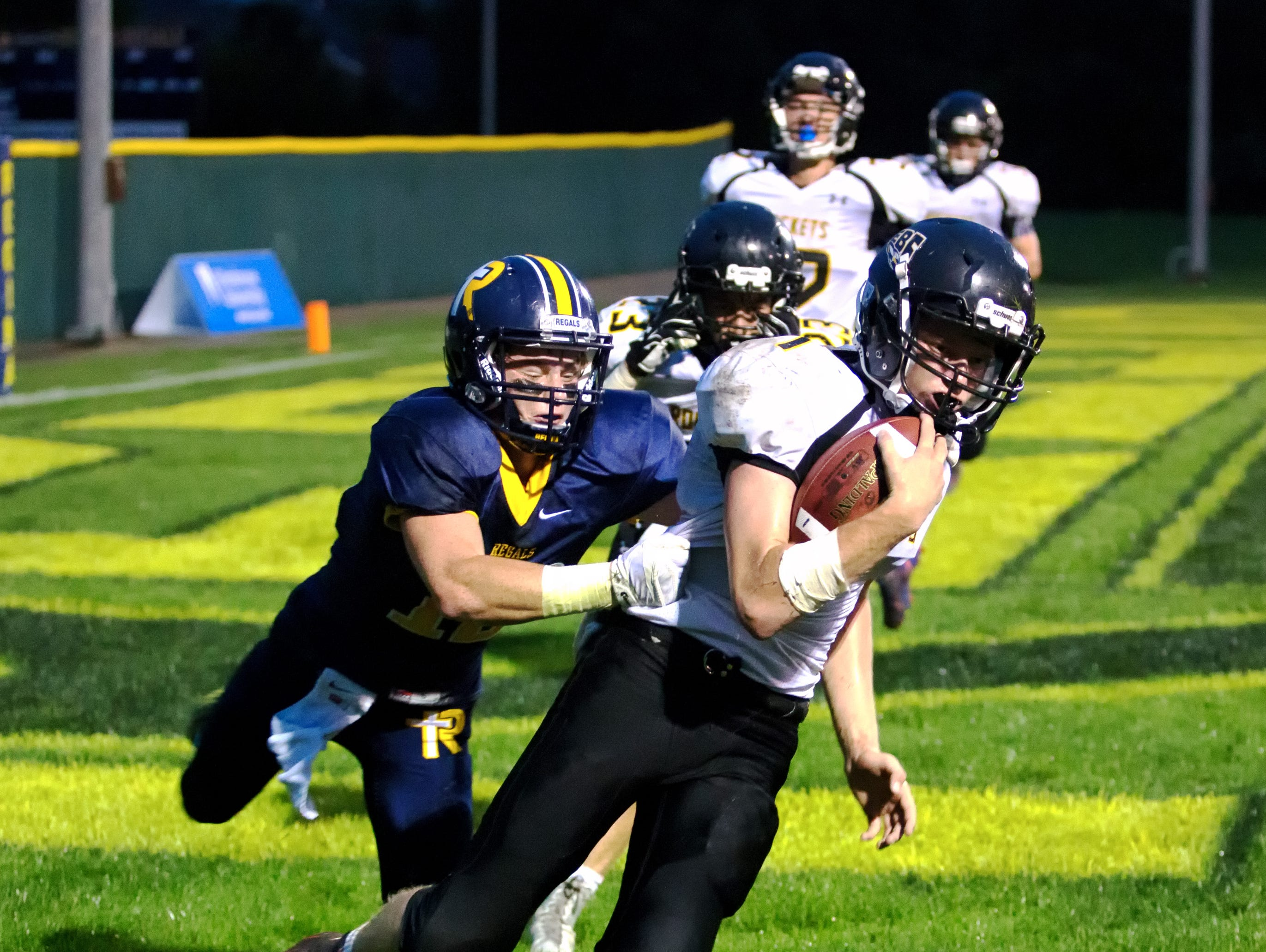 Class 1A top-ranked Regina's Ethan Suchomel tackles Eddyville-Blakesburg-Fremont's Ryan Adams for a safety on Sept. 18. The Regals travels to Highland for a 7 p.m. matchup on Friday.