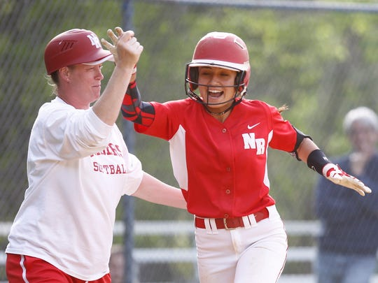 North Rockland's Victoria Alonso (20) rounds the bases with a homerun during a softball game at Suffern High School in Suffern on Wednesday, May 11, 2016.