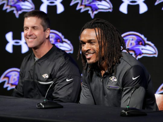 "FILE - In this March 20, 2017, file photo, newly signed Baltimore Ravens cornerback Brandon Carr, right, speaks alongside coach John Harbaugh during an introductory news conference at the NFL football team's practice facility in Owings Mills, Md. Ravens moved quickly in free agency to enhance a defense that faltered in the latter stage of a disappointing 8-8 season. General manager Ozzie Newsome fortified the backfield by signing Carr and safety Tony Jefferson. He also retained free agent nose tackle Brandon Williams with a $54 million, five-year deal. ""We came out of the gates quick, we were aggressive, really turning over every stone,"" Harbaugh said. (AP Photo/Patrick Semansky, File)"