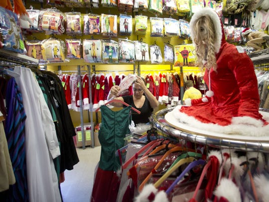 Shawna Wells picks out Christmas-themed costumes at