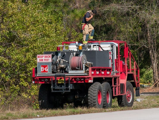 635959038021922090-palm-bay-brush-truck1.jpg