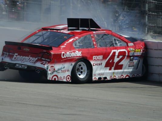 Kyle larson ok after hard crash into fontana wall for Larson motors used cars