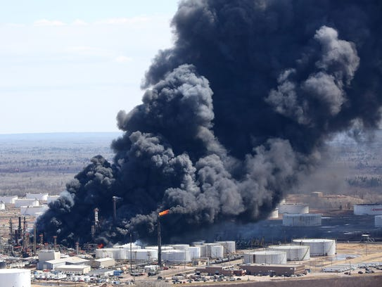 Thick smoke pours from the fire at the Husky Energy