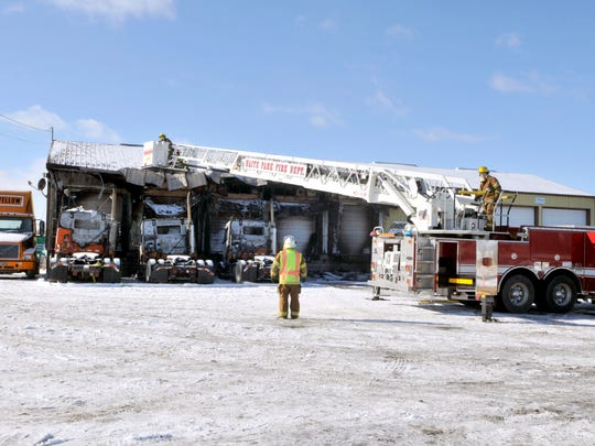 Waite Park firefighters cut through the roof of Emerald