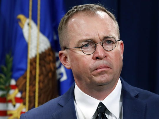 """FILE- In this July 11, 2018, file photo Mick Mulvaney, acting director of the Consumer Financial Protection Bureau (CFPB), and Director of the Office of Management, listens during a news conference at the Department of Justice in Washington. White House chief of staff Mulvaney said in an interview with """"Fox News Sunday"""" Democrats will """"never"""" see President Donald Trump's tax returns. Mulvaney says Democrats just want """"attention"""" and are engaging in a """"political stunt"""" after the chairman of the House Ways and Means Committee, Rep. Richard Neal, asked the IRS to provide six years of Trump's personal tax returns and the returns for some of his businesses. (AP Photo/Jacquelyn Martin, File)"""
