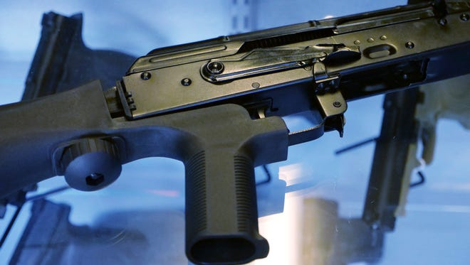"""A device called a """"bump stock"""" is attached to a semi-automatic rifle."""