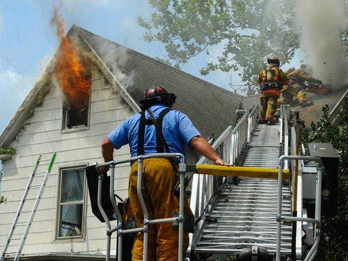 Salisbury and Delmar firefighters battle a blaze at 220 N Division Street on Thursday afternoon. Three ladder trucks as well as several tankers and ambulances were on the scene to assist.