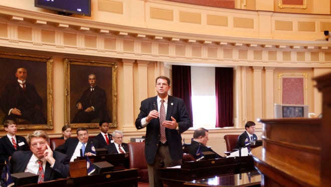 State Sen. Richard Stuart, R-Stafford, stands as he addresses the Senate during debate on a bill that would allow hunting on Sunday during the Senate session at the Capitol in Richmond, Va., Thursday, Jan. 26, 2012.