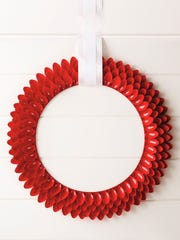 A spoon wreath has four rows of red spoons for a unique holiday wreath.