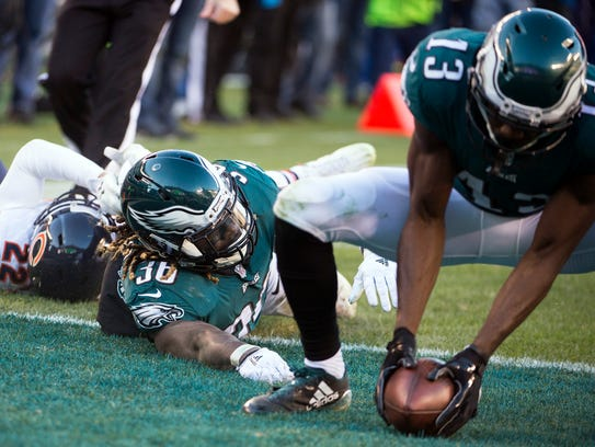 Eagles' Jay Ajayi (36) fumbles the ball into the end