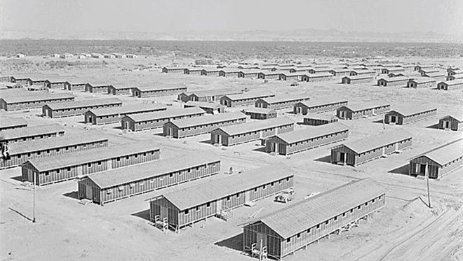 Living quarters of evacuees of Japanese ancestry at this War Relocation Authority center as seen from the top of water tower facing south west in Poston, Arizona on June 1, 1942.