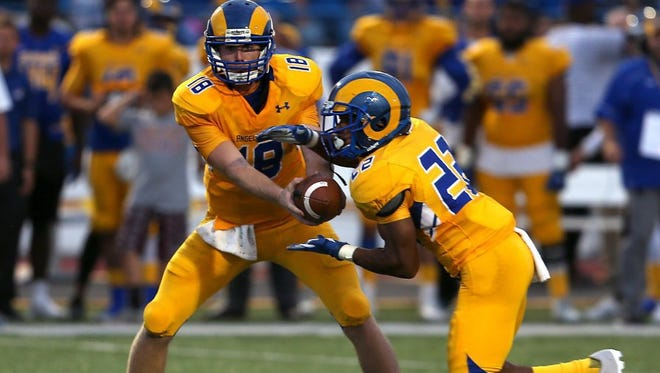 Angelo State quarterback Carsen Cook hands the ball off to Josh Stevens last year. Both players are back to help spark an offense that finished last in the Lone Star Conference in 2016.