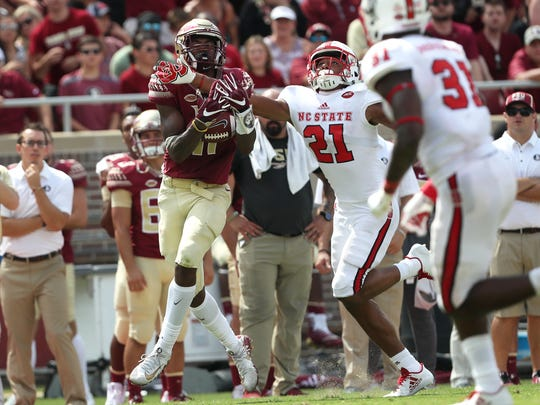 FSU's George Campbell catches the ball over NC State's Nick McCloud during the Seminoles home opener at Doak Campbell Stadium on Saturday.