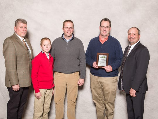 Pioneer Territory Manager Jeff King is pictured with Will, Brad and Bryan Clements, who accepted the second place protein content award from Kentucky Soybean Board Chair Davie Stephens.