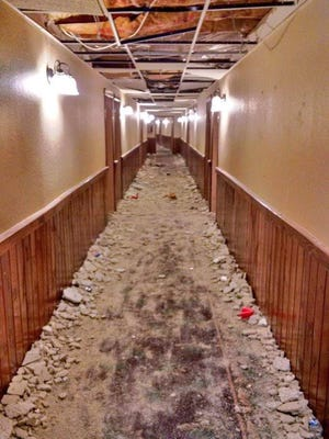 University of Michigan fraternity members are accused of causing significant damage to 45 rooms, including this hallway at Treetops Resort in Dover Township near Gaylord in Michigan.