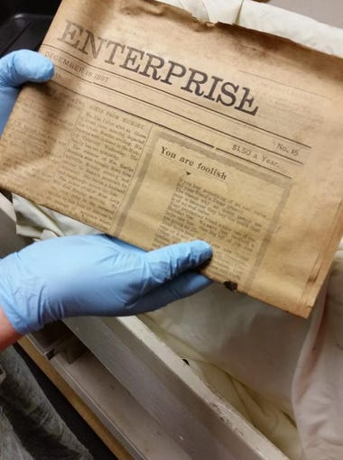 An archivist at the Western Regional Archives holds
