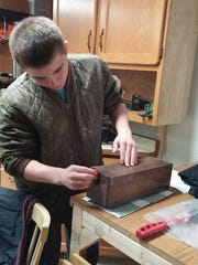With the help of his father, Steve, Kyle Schwartz has taken up woodworking to help fill the void left after his wrestling season ended.