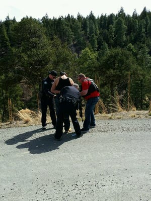 Ruidoso Police officers (left to right) Daniel Hildman, Sgt. Mike Weaver and Det. John Lund take Jeremy A. Netsinneh of Mescalero into custody.