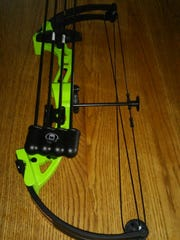 Lovina's youngest son Kevin was happy to get a compound bow for his birthday.