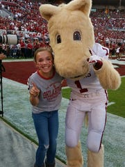 Palmyra gymnast Cael Bixler got to meet the Oklahoma Sooner mascot during a recruiting visit.