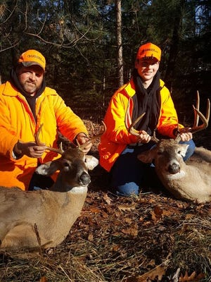 Randy and Kody Adamski, father and son, with their opening weekend bucks.