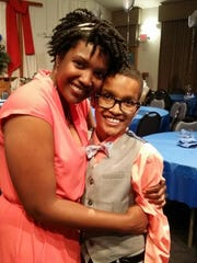 Jaden Woodard, with his mom, Betty, received a heart