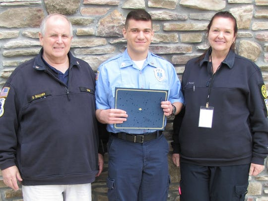 EMS Council of New Jersey (EMSCNJ) 2nd District Vice President Dan Sullivan congratulates Scotch Plains Rescue Squad members David Lugara, who recently won a cadet scholarship from the organization, and Patty Buckridee, who accepted the Gail Lawrence Scholarship for her daughter, Karolyn Buckridee, a member of the Scotch Plains and Fanwood rescue squads.