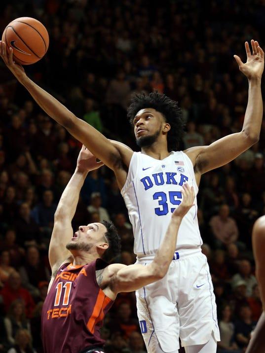 Duke's Marvin Bagley III (35) grabs an offensive rebound over Virginia Tech's Devin Wilson (11)  during the first half of an NCAA college basketball game Monday, Feb. 26, 2018, in Blacksburg, Va. (Matt Gentry/The Roanoke Times via AP)