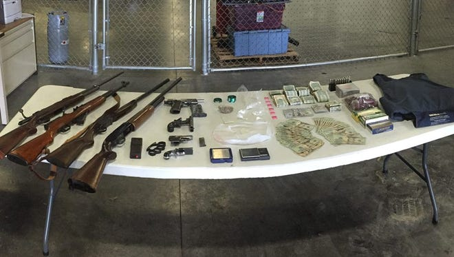 Items seized from two alleged Fort Myers drug houses.