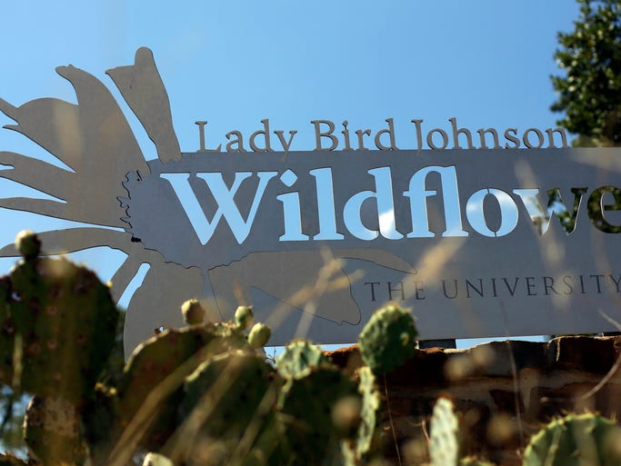 A sign is posted at the entry to the Lady Bird Johnson Wildflower Center in Austin, Texas.