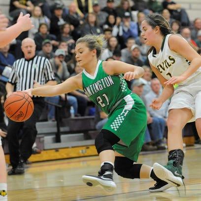 Huntington's Emily Haubeil fights for a loose ball
