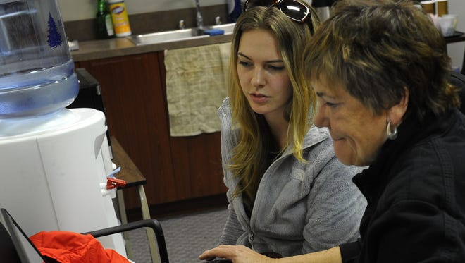 Katelyn Carrick gets help from volunteer Tanya Radic  signing up for insurance through the Affordable Care Act website in December.