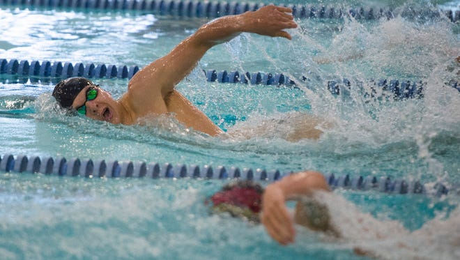 Danny Kovac of Fossil Ridge High School competes in the 200-yard freestyle during the Fort Collins City Meet at Edora Pool and Ice Center on Saturday, April 15, 2017.