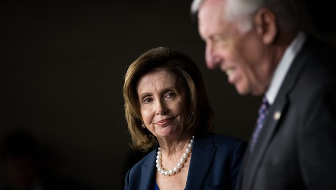 House Minority Leader Nancy Pelosi, D-Calif., listens as Rep. Steny Hoyer, D-Md., speaks during a news conference to discuss the rhetoric of presidential candidate Donald Trump, at the U.S. Capitol, May 11, 2016, in Washington, D.C.