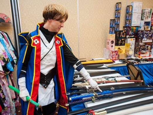 "Benjamin Messer, costumed as the character Jin Kisaragi from the series ""BlazBlue"", shops for prop weapons during the LouisiAnime convention at the Hilton Lafayette in Lafayette, LA, Saturday, June 14, 2014. The convention was held to celebrate anime, or Japanese animation, and the surrounding culture.  Paul Kieu, The Advertiser"