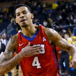 Southern Methodist Mustangs guard Keith Frazier (4) celebrates after the game against the Michigan Wolverines at Crisler Center on December 20, 2014.