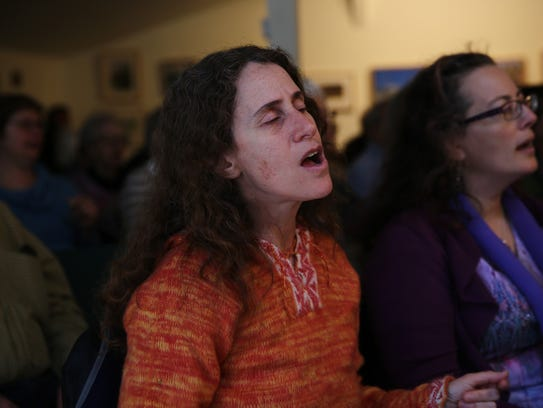 Rosendale resident Diane Zuckerman sings out on Sunday